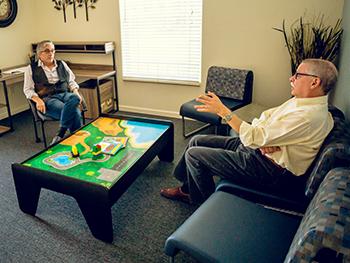 Professor Jeffrey Gilger (left) and Vice Chancellor Sam Traina discuss the future of the new center.