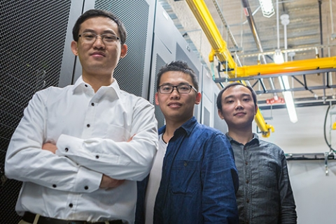 Professor Dong Li and graduate student researchers Yingchao Huang, center, and Luanzheng Guo are trying to improve supercomputing efficiency.