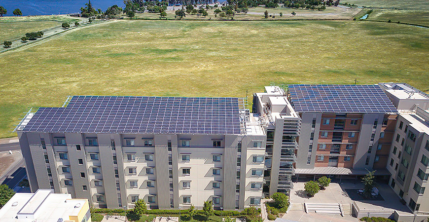 Solar panels atop campus buildings are just one factor in the campus's carbon neutrality.