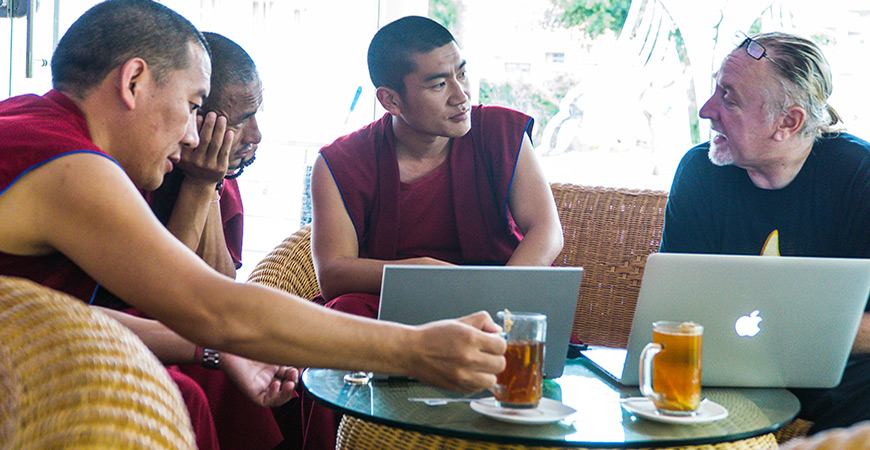 The monks take tea with Professor Noelle and continue discussing concepts in neuroscience.
