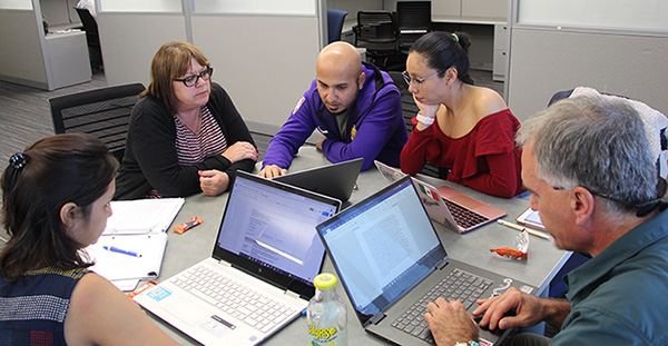 A group of Luce Foundation fellows work together in Professor Robin DeLugan's Interdisciplinary Humanities course. From left to right: Ekta Kandhway, Robin DeLugan, Alfredo Gaona, Miriam Campos Martinez, and Scott Nicolay.