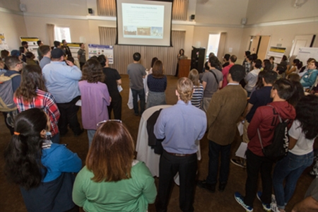 Attendees listen to a presentation during the MACES open house.