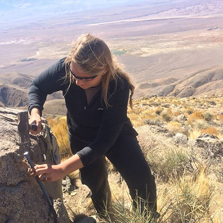 Morgan Barnes collecting rock samples in the White Mountains (California).