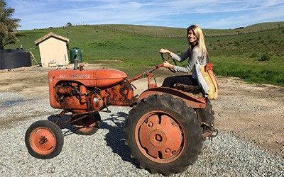 Growing up, Andrade loved playing with tools and tinkering with her grandfather's old Allis-Chalmers tractor.