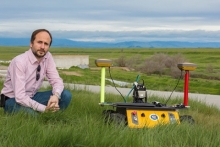 Professor Stefano Carpin and one of his robots
