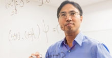 Professor Im stands before a mathematical equation.